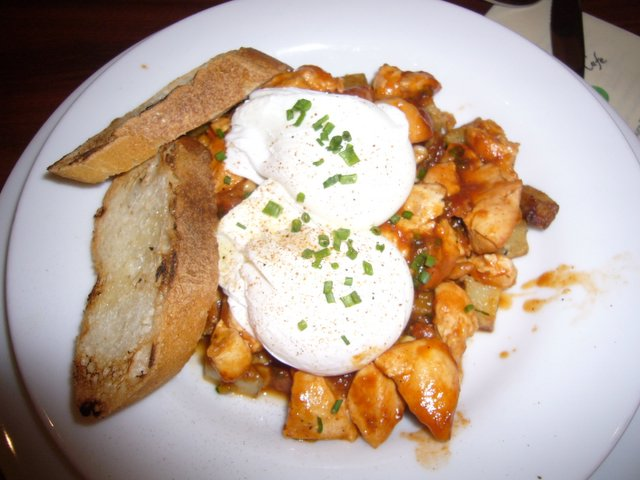 andouille sausage and sweet corn hash with poached eggs and